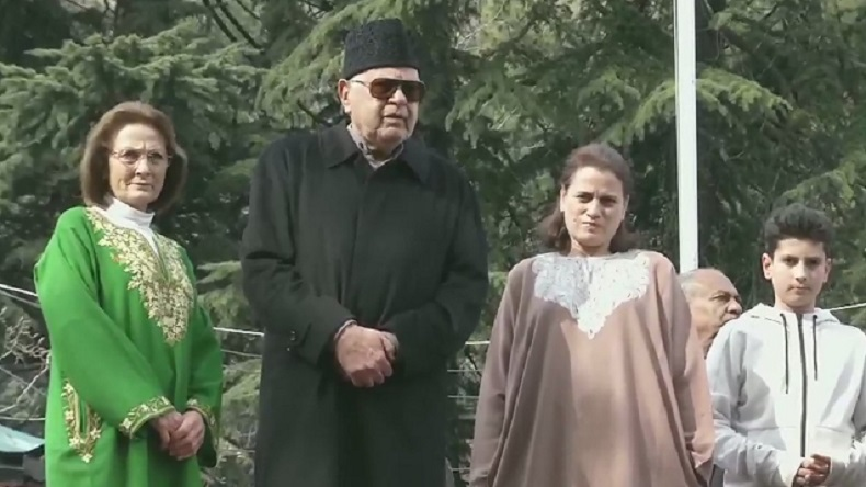 Former Jammu and Kashmir CM Farooq Abdullah standing outside his house after being released